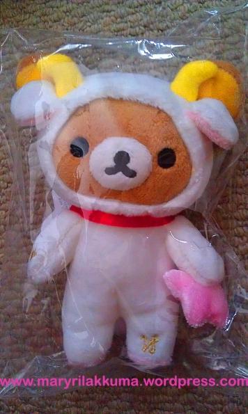Capricon!  Rilakkuma is snug in his little white goat suit :P