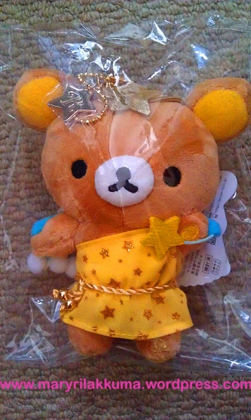 Libra!  He's balancing a dango and a small gold star, so cute!