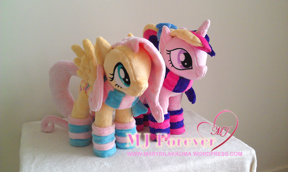 Fluttershy and Foalsitter Princess Cadance in their winter gear!  Both by navkaze